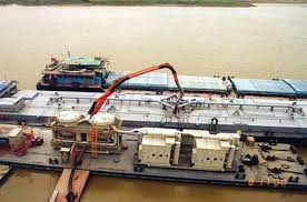 Figure 8: Barge Mounted Unloader (Photo courtesy of FLSmidth)